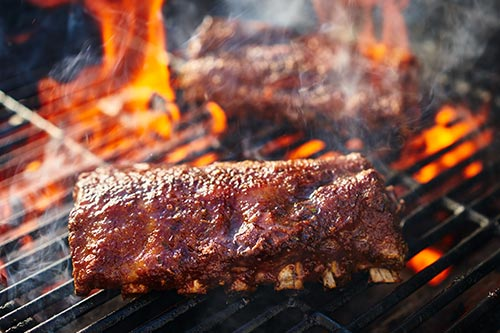 Ribs being cooked on a open flame